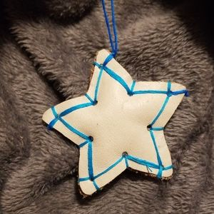 2 for $10.   White leather star charm